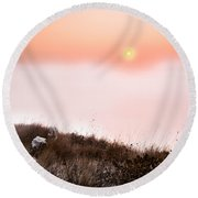 Between Rocks And The Sunrise Round Beach Towel
