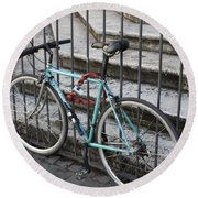 Bicycle Is Chained To A Fence Round Beach Towel