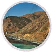 Big Sur And The Bridge Round Beach Towel by Adam Jewell