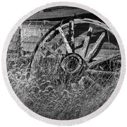 Black And White Photo Of An Old Broken Wheel Of A Farm Wagon Round Beach Towel