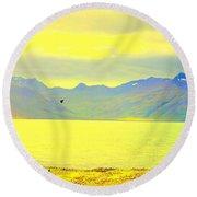 A Black Bird Is Crossing The Golden Landscape Round Beach Towel