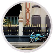 Blue Yellow Sporty Motorcycle Parked On Pavement Round Beach Towel