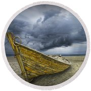 Boat On The Beach With Oncoming Storm Round Beach Towel