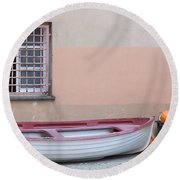 Boat Under A Window Round Beach Towel