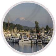 Boats Docked At A Harbor With Mountain Round Beach Towel