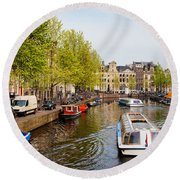 Boats On Canal Tour In Amsterdam Round Beach Towel