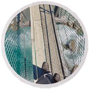 Boots On Swing Bridge Over Troubled White Water Round Beach Towel