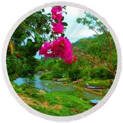 Bouganvilla Watches Over Village Fishing Boats Round Beach Towel