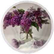 Bouquet Of Lilacs In A Glass Pot Round Beach Towel