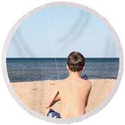Boy At The Beach Flying A Kite Round Beach Towel