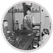 Boy Making A Pyramid Of Cards Round Beach Towel by Underwood Archives
