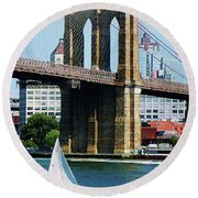 Bridge - Sailboat By The Brooklyn Bridge Round Beach Towel