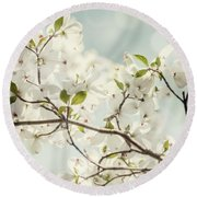 Bright White Dogwood Flowers Against A Pastel Blue Sky With Dreamy Bokeh Round Beach Towel