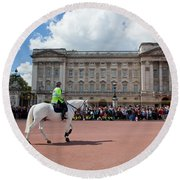 British Royal Guards Riding On Horse And Perform The Changing Of The Guard In Buckingham Palace Round Beach Towel
