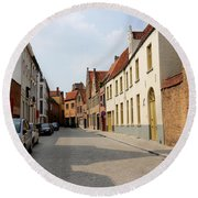Bruges Side Street Round Beach Towel by Carol Groenen