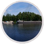 By A Canal Panorama Round Beach Towel