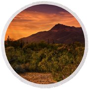 By The Light Of The Sunset Round Beach Towel