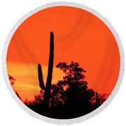 Cactus Against A Blazing Sunset Round Beach Towel