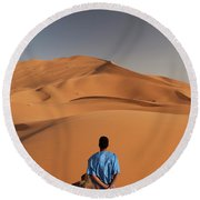 Camels In Sahara Desert. Erg Chebbi Round Beach Towel