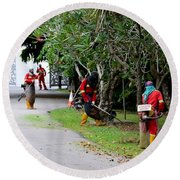 Camouflaged Leaf Blowers Working In Singapore Park Round Beach Towel