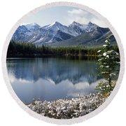 1m3541-canadian Peak Reflected In Herbert Lake Round Beach Towel