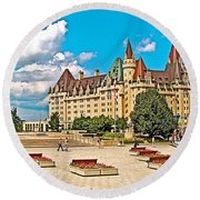 Canadian War Memorial And Chateau Laurier In Ottawa-ontario  Round Beach Towel