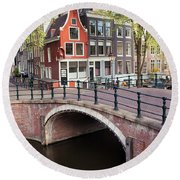 Canal Bridge And Houses In Amsterdam Round Beach Towel