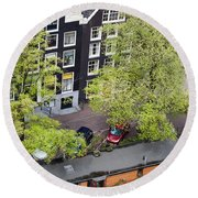 Canal Houses And Houseboat In Amsterdam Round Beach Towel