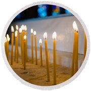 candles in the Catholic Church shallow depth of field Round Beach Towel