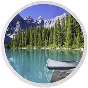 Canoes In Moraine Lake And Valley Of Round Beach Towel
