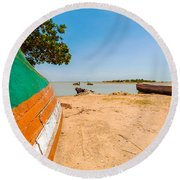 Canoes On A Lakeshore Round Beach Towel