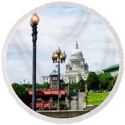 Capitol Building Seen From Waterplace Park Round Beach Towel by Susan Savad