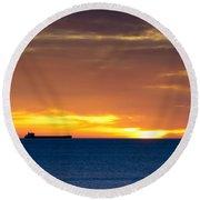 Cargo Ship On Horizon At Dawn Round Beach Towel
