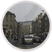 Cars And Buildings On The Streets Of Edinburgh Round Beach Towel