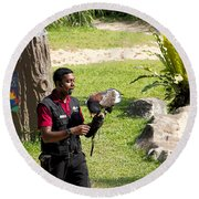 Cartoon - A Trainer And A Large Bird Of Prey At A Show Inside The Jurong Bird Park Round Beach Towel