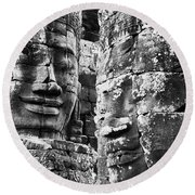 Carved Stone Faces In The Khmer Temple Round Beach Towel