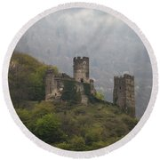 Castle In The Mountains. Round Beach Towel