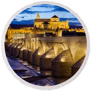 Cathedral Mosque And Roman Bridge In Cordoba Round Beach Towel