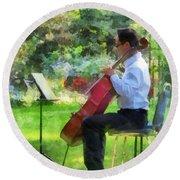 Cellist In The Garden Round Beach Towel