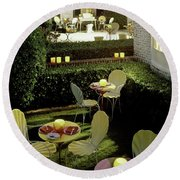 Chairs And Tables In A Garden Round Beach Towel