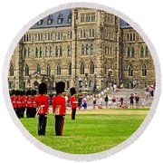 Changing Of The Guard In Front Of Parliament Building In Ottawa- Round Beach Towel