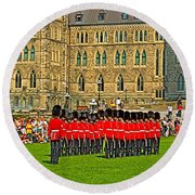 Changing Of The Guard In Front Of The Parliament Building In Ottawa-on Round Beach Towel