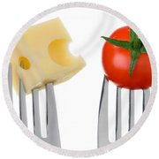 Cheese And Tomato On Forks Against White Round Beach Towel