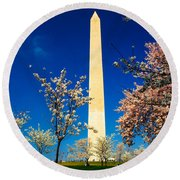 Cherry Blossoms At The Monument Round Beach Towel