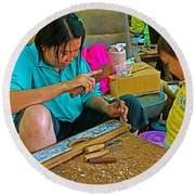 Child Watches As Mom Works In Teak Wood Carving Shop In Kanchanaburi-thailand Round Beach Towel