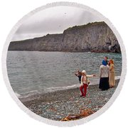Children Throwing Capelin Back Into The Ocean At Middle Cove-nl Round Beach Towel