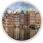 City Of Amsterdam At Sunset In Netherlands Round Beach Towel