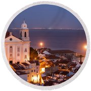 City Of Lisbon In Portugal At Night Round Beach Towel