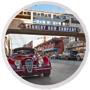 Classic Cannery Row - Monterey California With A Vintage Red Car. Round Beach Towel
