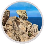 cliff in San Pietro island Round Beach Towel